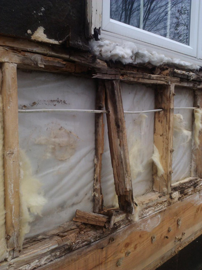 After taking the existing siding off the home above, this is what is underneath