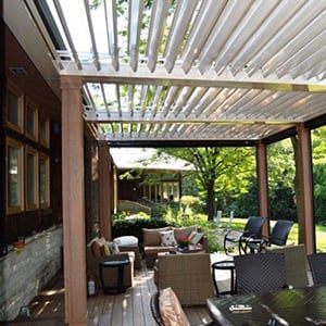 A louvered roof that opens and closes to keep sun in and rain out!